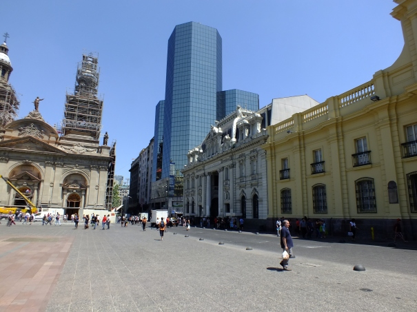 Yellow building is national museum, next the post office, then, to left, with scaffolds, a cathedral.